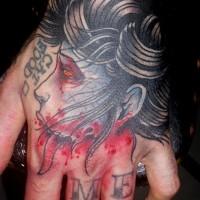 Creepy old school hand tattoo of bloody zombie woman head