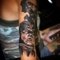 Creepy realistic looking shoulder tattoo of evil half human half werewolf