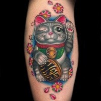 Cute and funny looking leg tattoo of colored maneki neko japanese lucky cat tattoo on leg
