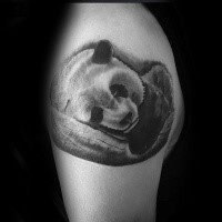 Cute and very beautiful shoulder tattoo of sleeping panda