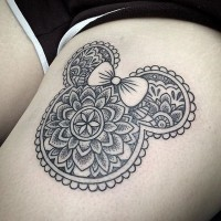 Cute black ink Minnie mouse shaped tattoo on thigh stylized with ornamental flowers