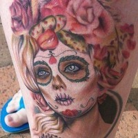 Cute blonde santa muerte girl tattoo on leg