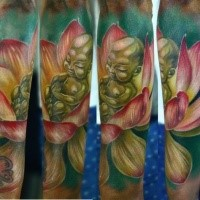 Cute cartoon style colored forearm tattoo of small Buddha statue with lotus flower