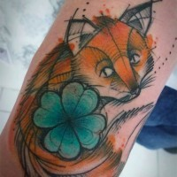 Cute cartoon style colored sad fox with clover tattoo on arm