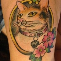 Cute cat with collar in frame with pink flower tattoo in old school style