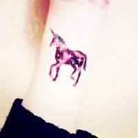 Cute colored little wrist tattoo of sparling unicorn