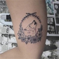 Cute dot style biceps tattoo of wolf portrait with flowers