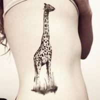 Cute giraffe tattoo on ribs