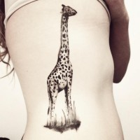 Cute giraffe tattoo on ribs