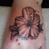 Cute gray ink hibiscus flower tattoo on left foot