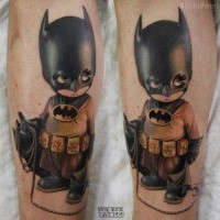 Cute illustrative style leg tattoo of baby Batman