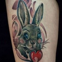 Cute illustrative style thigh tattoo of beautiful rabbit and red apple