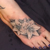 Cute lily tattoo on foot design