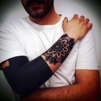 Cute little colored flower tattoo on wrist