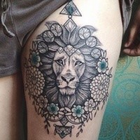 Cute looking colored thigh tattoo of lion head stylized with various flowers
