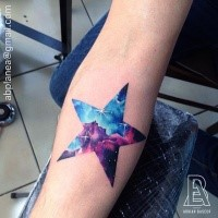 Cute star shaped big forearm tattoo stylized with space