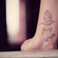 Cute two soaring birds tattoo on wrist