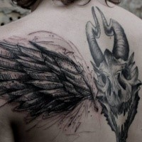 Dark black ink demonic goat skull with wing