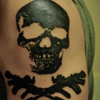 Dark black ink designed skull and crossed bones pirate shoulder tattoo in homemade style