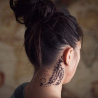 Dark black ink homemade style pair of feather designed neck tattoo behind ear