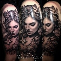 Dark black ink shoulder tattoo of woman with butterfly and flowers