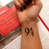 Dark black ink symbolic numbers 9 3/4 wrist tattoo