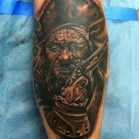 Dark ink gun pirate face tattoo on leg