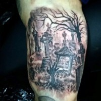 Dark old memorial cemetery tattoo on arm with lettering