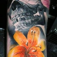 Dark skull with yellow tiger lily tattoo