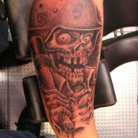 Death in a military helmet tattoo on leg