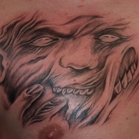 Demon face tattoo on chest by fiesta