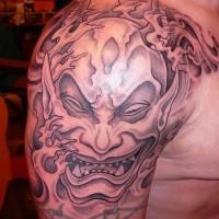 Demon in asian style tattoo on shoulder by fiesta