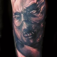 Demon tattoo on arm