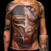 Demon tattoo on stomach and chest