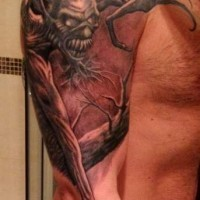 Demon with long arms tattoo on half sleeve