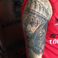 Detailed black and white shoulder tattoo of old Roman arena with gladiator warrior