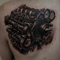 Detailed black ink scapular tattoo of big car engine