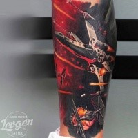 Detailed colorful leg tattoo of Star Wars space ship