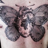 Detailed Engraving style chest tattoo of human heart stylized with world map and wings