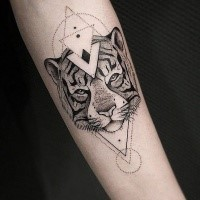 Dot style black ink arm tattoo of tiger head with geometrical figures