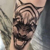 Dot style black ink forearm tattoo of demonic tiger