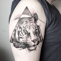 Dot style black ink shoulder tattoo of tiger head with triangle