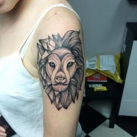 Dot style black ink shoulder tattoo of big lion head