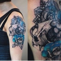 Dot style detailed and colored by Joanna Swirska upper arm tattoo of cat skull with flowers