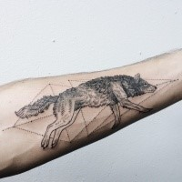 Dot style simple looking forearm tattoo of wolf with geometrical figures