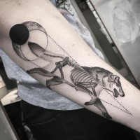 Dot style X-Ray like black ink forearm tattoo of running wolf with moon