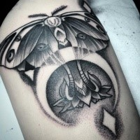 Dot work style nice looking tattoo of butterfly stylized with eyes