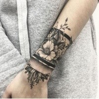 Dotwork style amazing detailed wrist tattoo of flowers