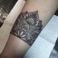 Dotwork style black ink leg tattoo of floral ornament
