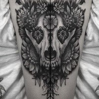 Dotwork style nice painted upper arm tattoo of animal skull combined with flowers by Dino Nemec